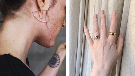 customer modeling THALIA hoops in bronze and customer's hand wearing PIRO ring in bronze as well as TAVIRA stacking rings in bronze and sterling silver