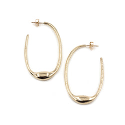 oval BEJA hoops in polished bronze from MGG Studio