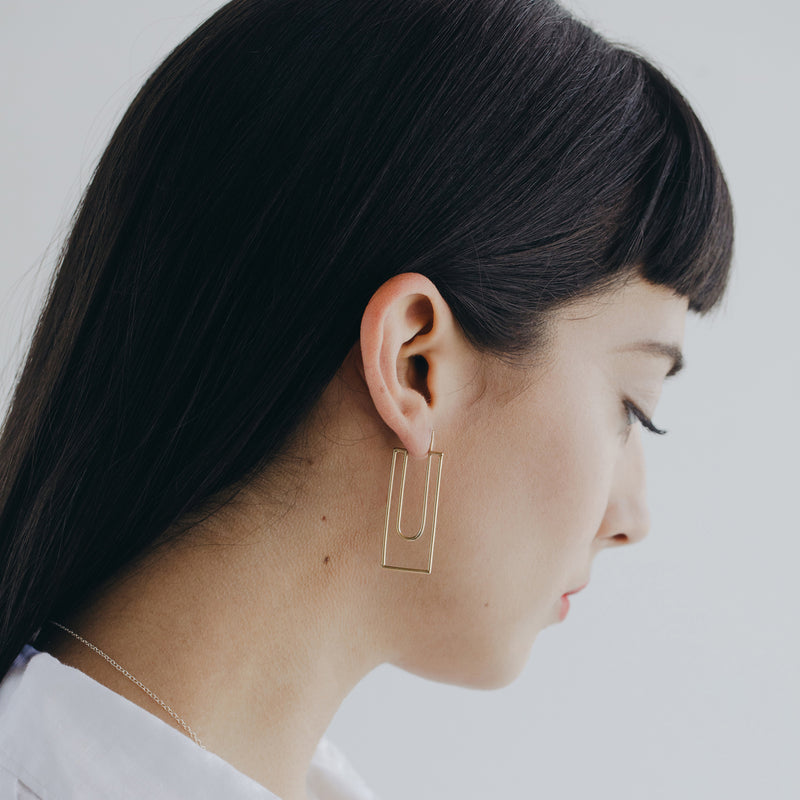 golden bronze geometric hoop earrings from MGG Studio