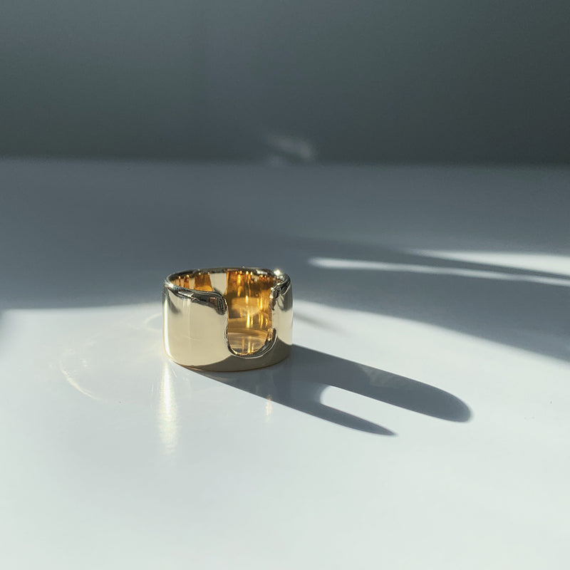 highly polished bronze wide statement ring with dramatic shadows from MGG Studio