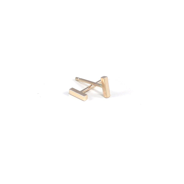 tiny 14k gold bar stud earrings handmade by MGG Studio in California
