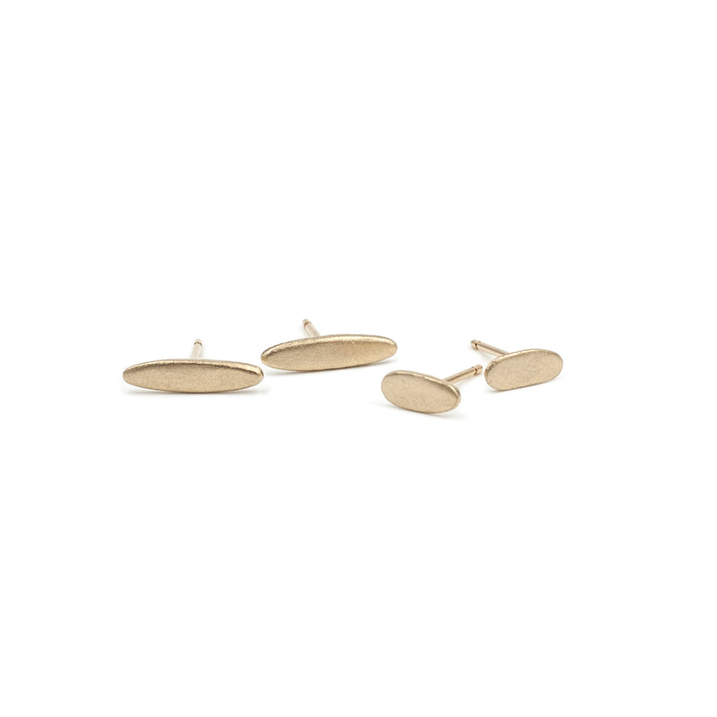 handmade matte recycled 14k yellow gold elongated gold studs from MGG Studio