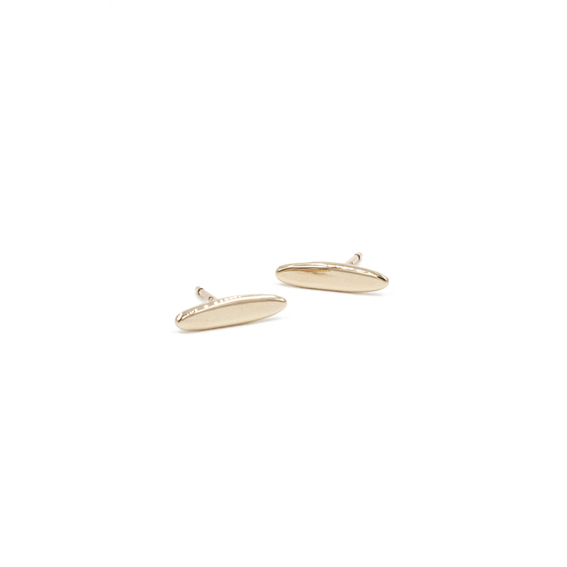 handmade polished recycled 14k yellow gold elongated gold studs from MGG Studio