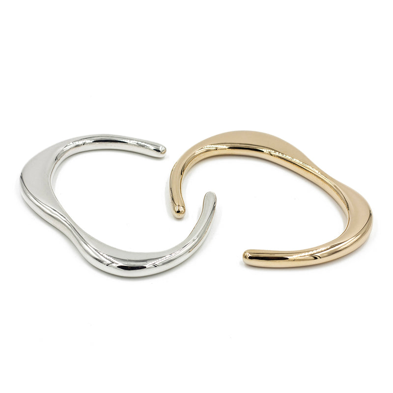 slim sculptural SINU cuff bracelet in bronze and silver from MGG Studio