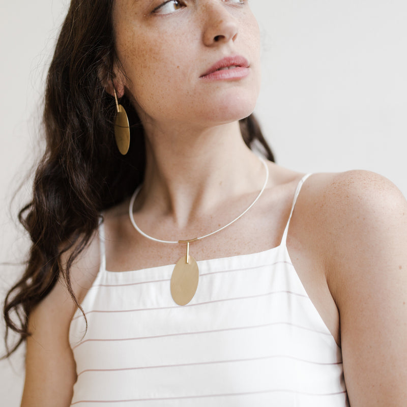 handmade TALA statement necklace on model from MGG Studio
