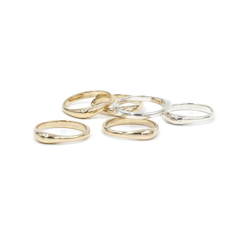 collection of bronze and sterling silver polished TAVIRA droplet stacking rings from MGG Studio