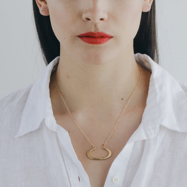 bronze THEA everyday necklace from MGG Studio on model