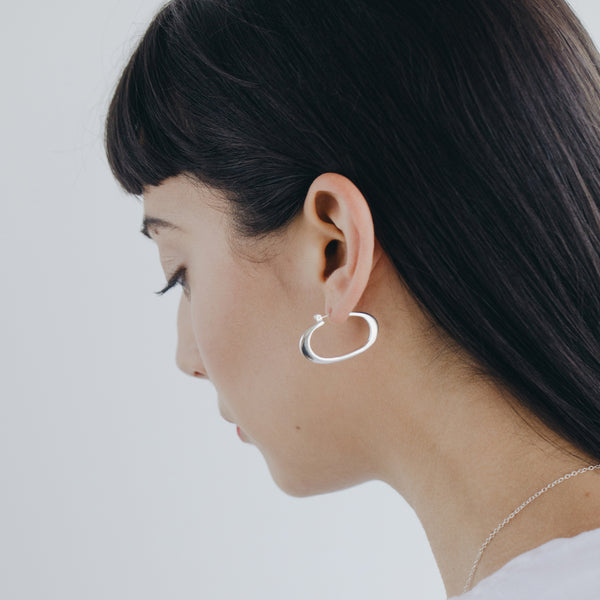 THEA horizontal oval hoops by MGG Studio on model