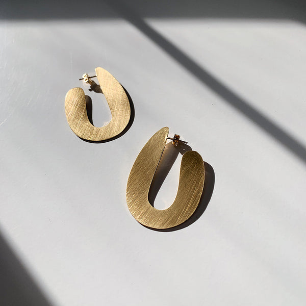 brushed brass modern post earrings in shadow from MGG Studio
