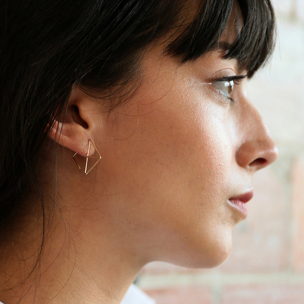 VELOS 14K gold ear hugs by MGG Studio on model