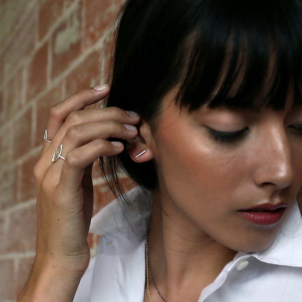 VIGA bar post earrings in recycled silver from MGG Studio on model