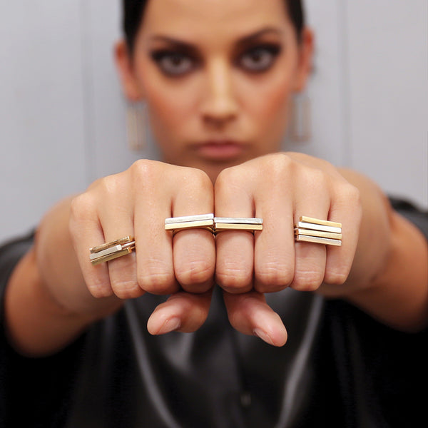 silver and bronze stacking rings by MGG Studio