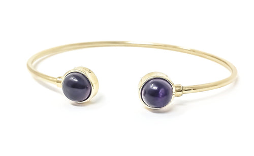 women's gold cuff bracelet with amethyst cabochons