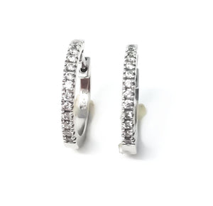 women's white gold and diamond huggie earrings