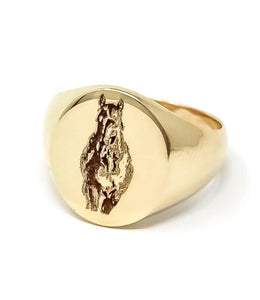 women's gold signet ring with horse engraving