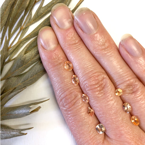 Peachy pink sapphires faceted on hand