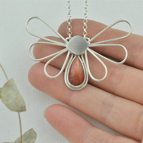 Movement and motion silver sunstone moth pendant