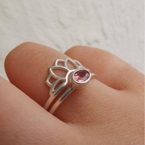 Pink peach sapphire silver lotus ring on hand