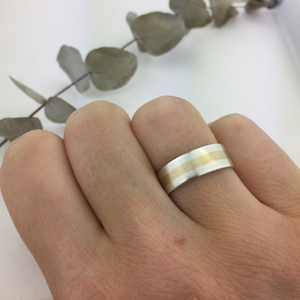 Silver and yellow gold stripe ring.