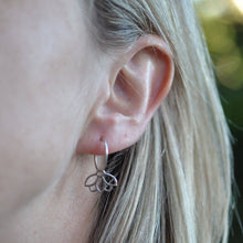 Diamond everyday sleeper hoops silver lotus earring, April birthstone.