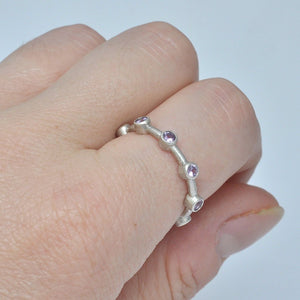 Pink sapphire recycled sterling silver Anniversary eternity band.