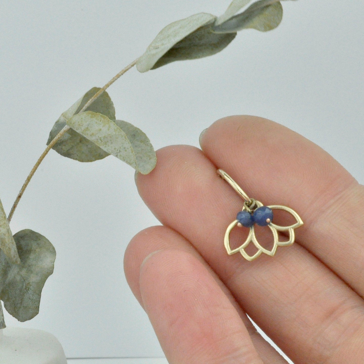 Single Sapphire small 9ct gold hoop earring, Lotus charm, September birthstone