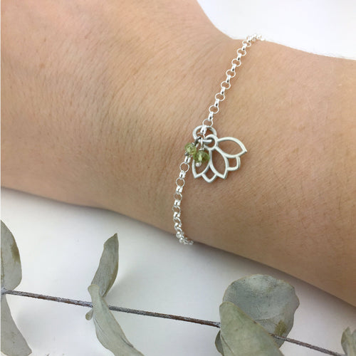 Peridot August Birthstone sterling silver bracelet with Lotus petal charm.
