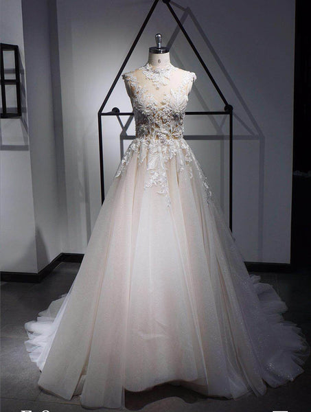 A-line wedding dress with court train and embroidered bodice with beads