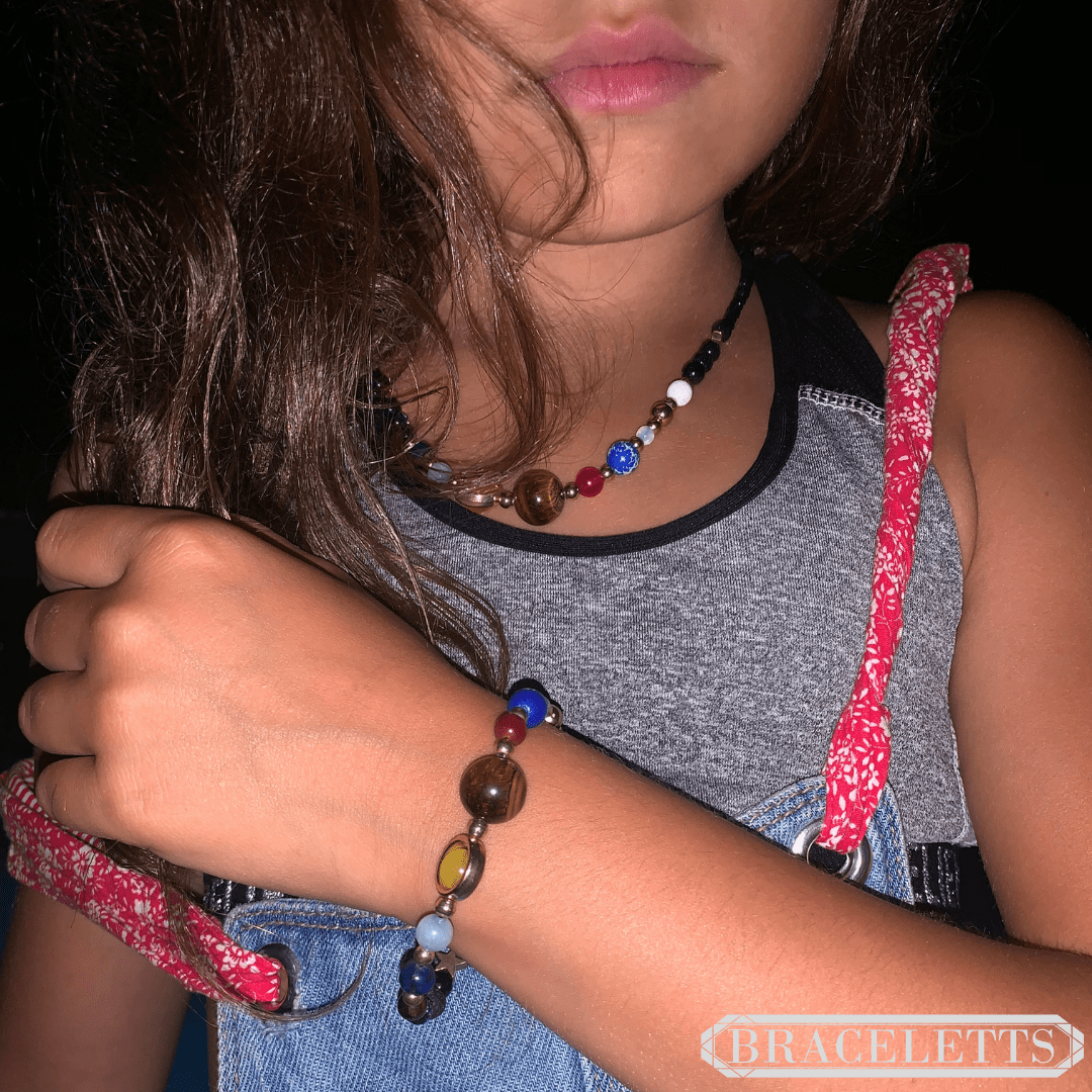 Young model with a Galaxy Necklace and a Galaxy Bracelet by Insignia Jewels