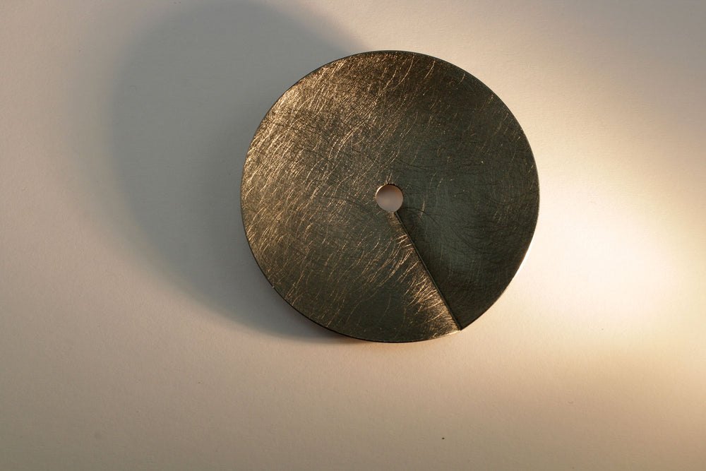 Circle brooch, burnished silver