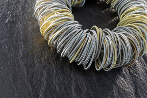 Bracelet, steel and golden springs