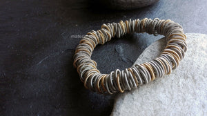 Bracelet, steel/gold springs