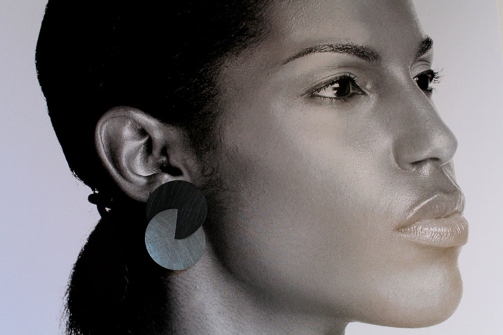 Earrings, burnished silver