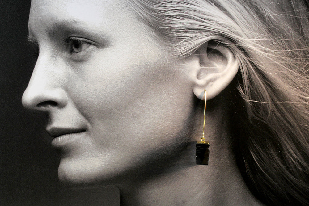 Earrings, transparent black glass