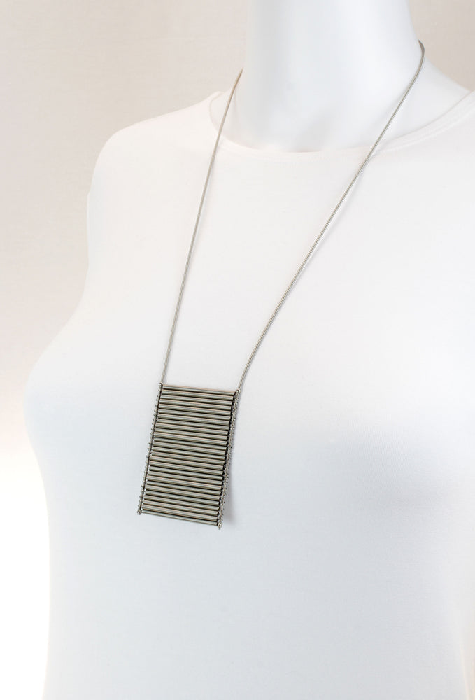 Necklace, steel spring amulete