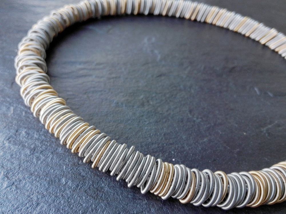 Necklace, steel/gold springs