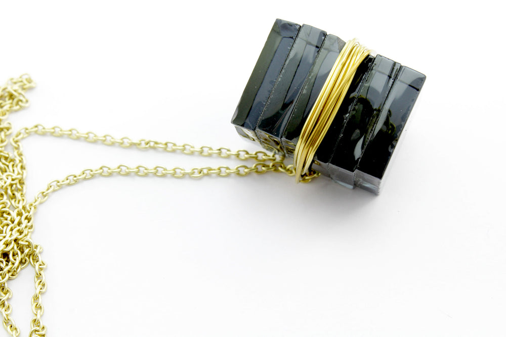 Necklace, transparent black glass