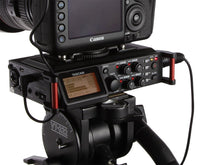 Load image into Gallery viewer, TASCAM digital recorder DR-70D on tripod