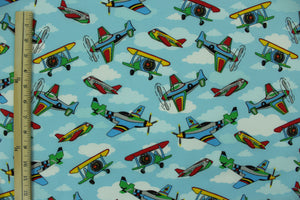 Primary Colored Airplanes on Light Blue with White Clouds