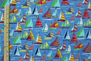 Colorful Sailboats on Blue Water