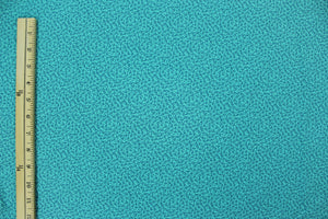 Small Blue Leaves and Dots on a Teal Background