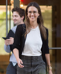 Jessica Alba wearing thin-rimmed glasses.