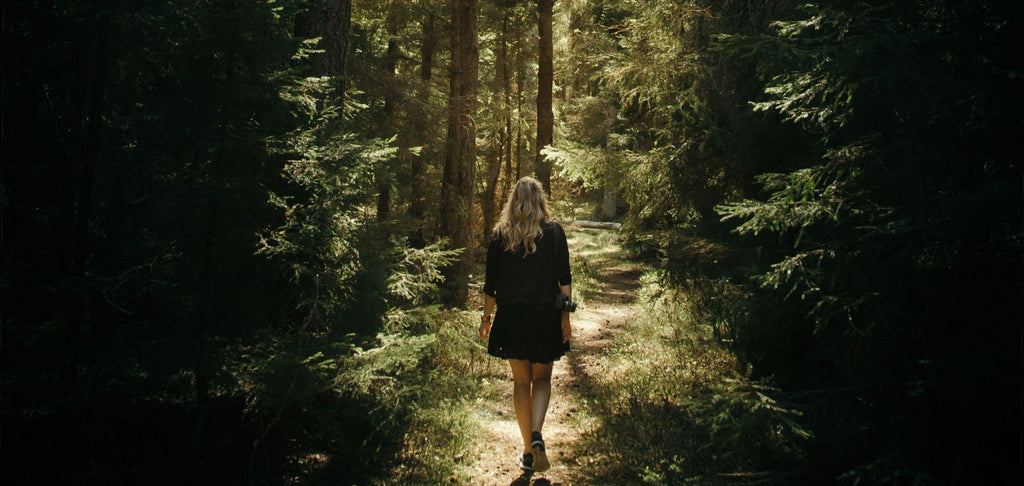 Image of woman walking in the woods