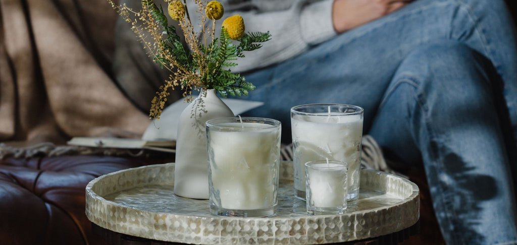 Image of scented candles on table in lounge