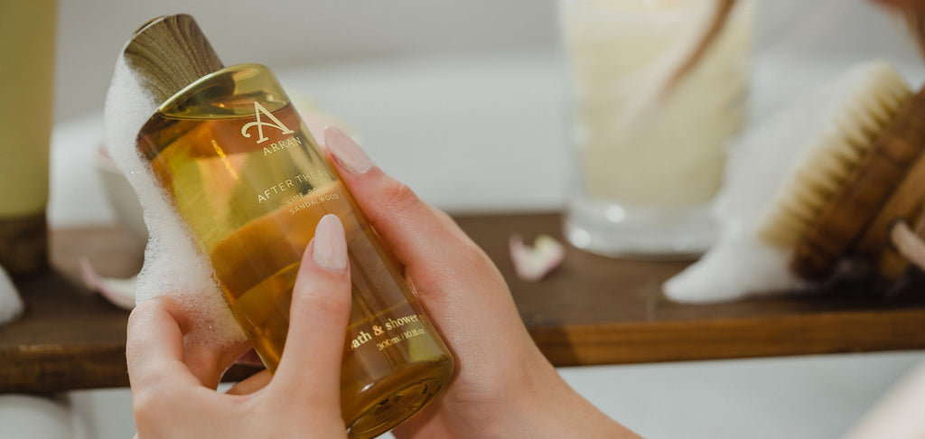 Image of woman holding an After the Rain Shower Gel in bath
