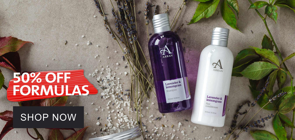 """Purple shampoo and conditioner bottles with text to say """"50% off Formulas. Shop Now"""""""