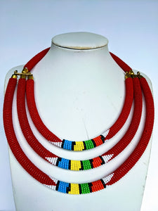 Three beautiful necklaces in one. Hand crafted using glass beads. Approximately 40 cm long