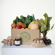 Load image into Gallery viewer, The Gluten-Free Box pictured is packed with organic fruits and vegetables like apples, beetroot, pumpkin, bananas, zuchini, onions, and more. There is also a bag of mushrooms, half a dozen eggs, and a jar of quice jelly as the Grocery Surprise.