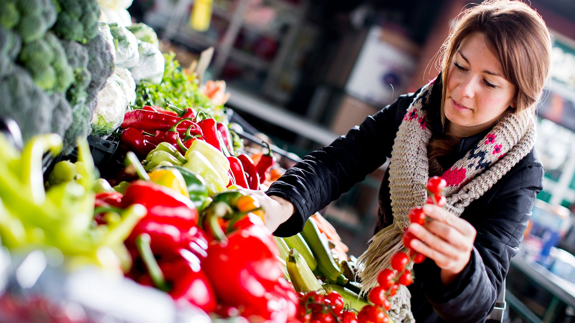Lady purchasing a vegetable