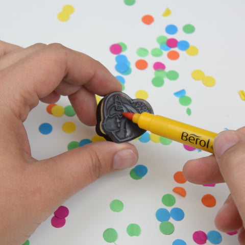 Stamp being coloured in with a pen